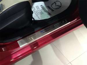Накладки на внешние пороги (нерж.) на Mazda 3 2013+